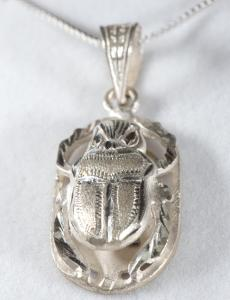 Scarab - in silver, carved on reverse with chain